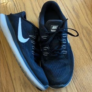 Women's black and white Nike athletic shoes